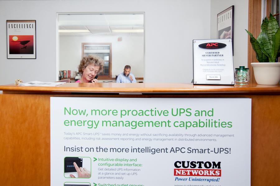 Photo Of Service Desk At APC Company - Custom Networks